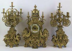 An imposing ormolu mantelpiece with candlesticks