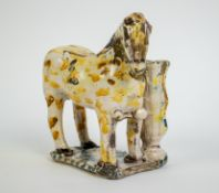 A Faience horse with vase, 18/19th C.