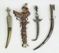 A collection of asian daggers