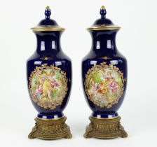 A pair of handpainted Sèvres style vases