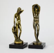 Male and female bronze figures