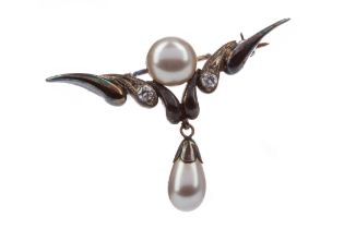 A FAUX PEARL AND GEM SET BROOCH