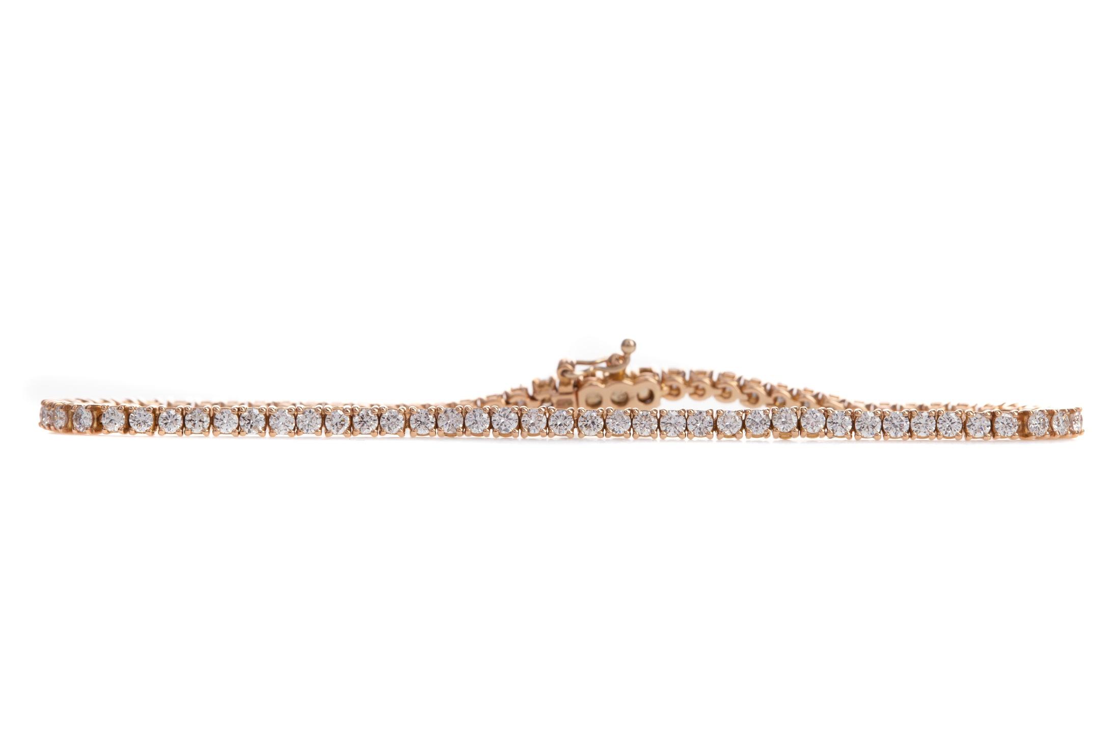 A ROSE GOLD DIAMOND TENNIS BRACELET