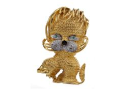 A DIAMOND SET LION BROOCH