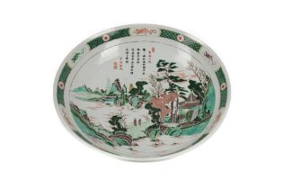 A 19TH CENTURY CHINESE FAMILLE VERTE SHALLOW BOWL