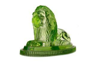 A LATE VICTORIAN URANIUM GLASS FIGURE OF A RECUMBANT LION