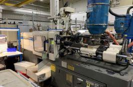 (1) 1992 Milacron 85 Ton Injection Molding Machine