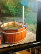 Brand new 1.9 m spruce hot tub with stainless log heater. chimney benches safety gate