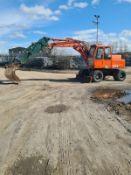 Atlas Rubber tyre excavator 16 ton 4 Cylinder deutz engine with front blad 10426 hours 4wd year 1993