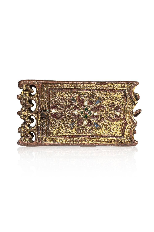Ornement nasrideEspagne, XIVème - XVème siècleBoucle de ceinture en métal bronzé à décor ciselé,