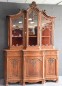 Double carved oak display case in the Liège style. End of the XIXth century. Height : 260 cm.