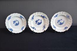 Set of three Tournai porcelain round dishes.
