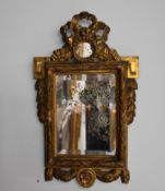 Small giltwood mirror from the Louis XVI period. Height : 60 cm.