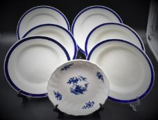Set of six porcelain plates of Tournai decorated with a blue border. There is a compotier with a