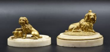 A pair of gilt bronze dogs on white marble bases. Late 18th century. One dog to be reattached. Total