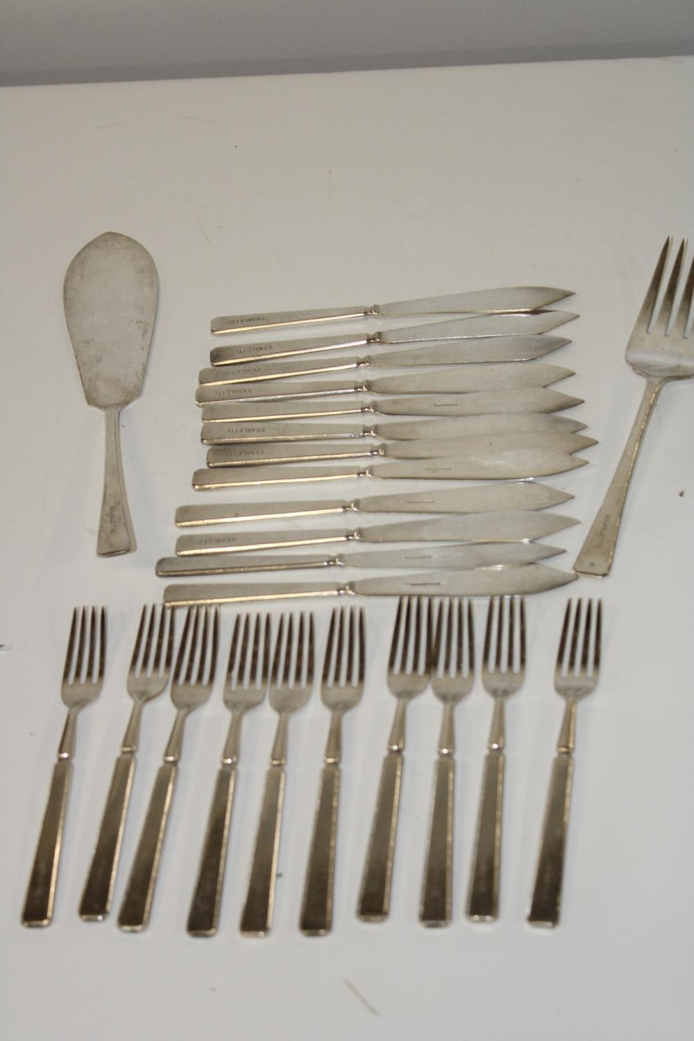 A selection of silver plated cutlery produced for the steam yacht Arlette launched in the 1930's.