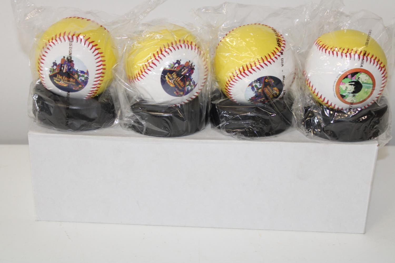 "A set of four Beatles ""Yellow Submarine"" baseballs"