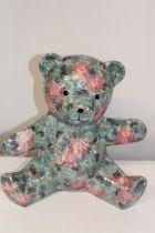 A large ceramic teddy bear. Height 28cm
