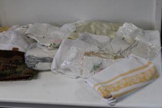 A box of vintage linen & table clothes etc