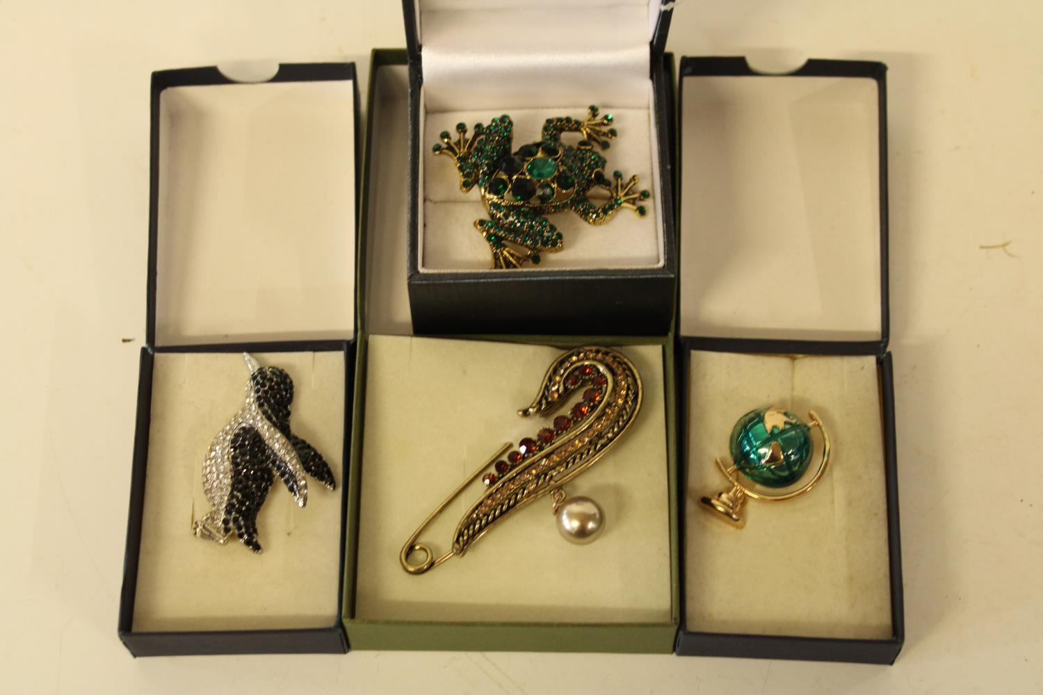 Four boxed high quality costume jewellery brooches