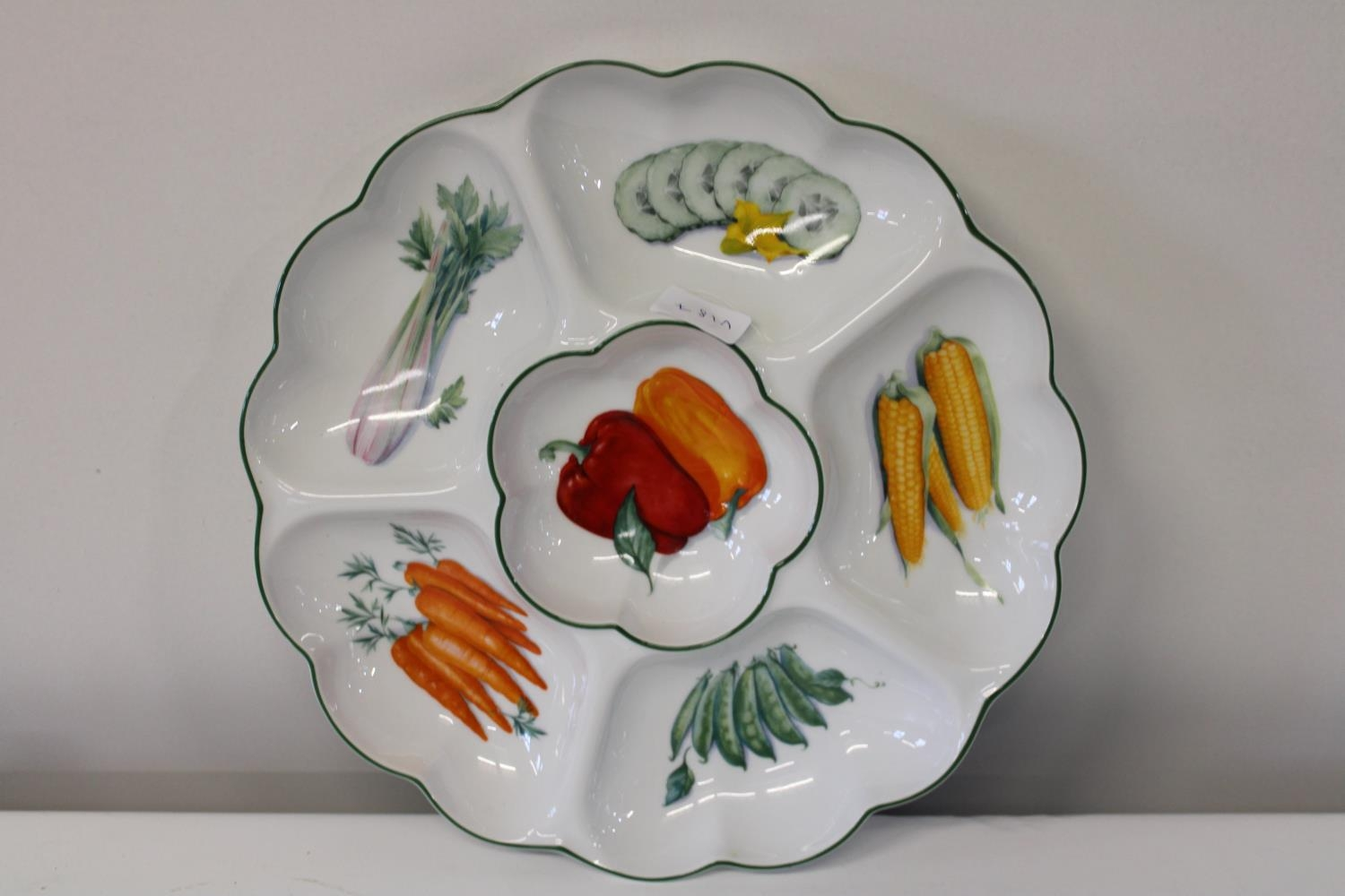 A Royal Worcester vegetable plate 34cm in dia