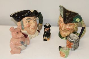 A selection of Royal Doulton toby jugs & other ceramics