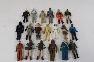 A selection of vintage Star Wars figures, from the 70's & 80's