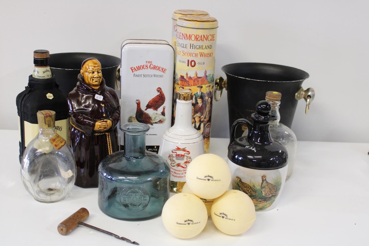 A job lot of vintage breweriana items, ice buckets, decanters, tins etc