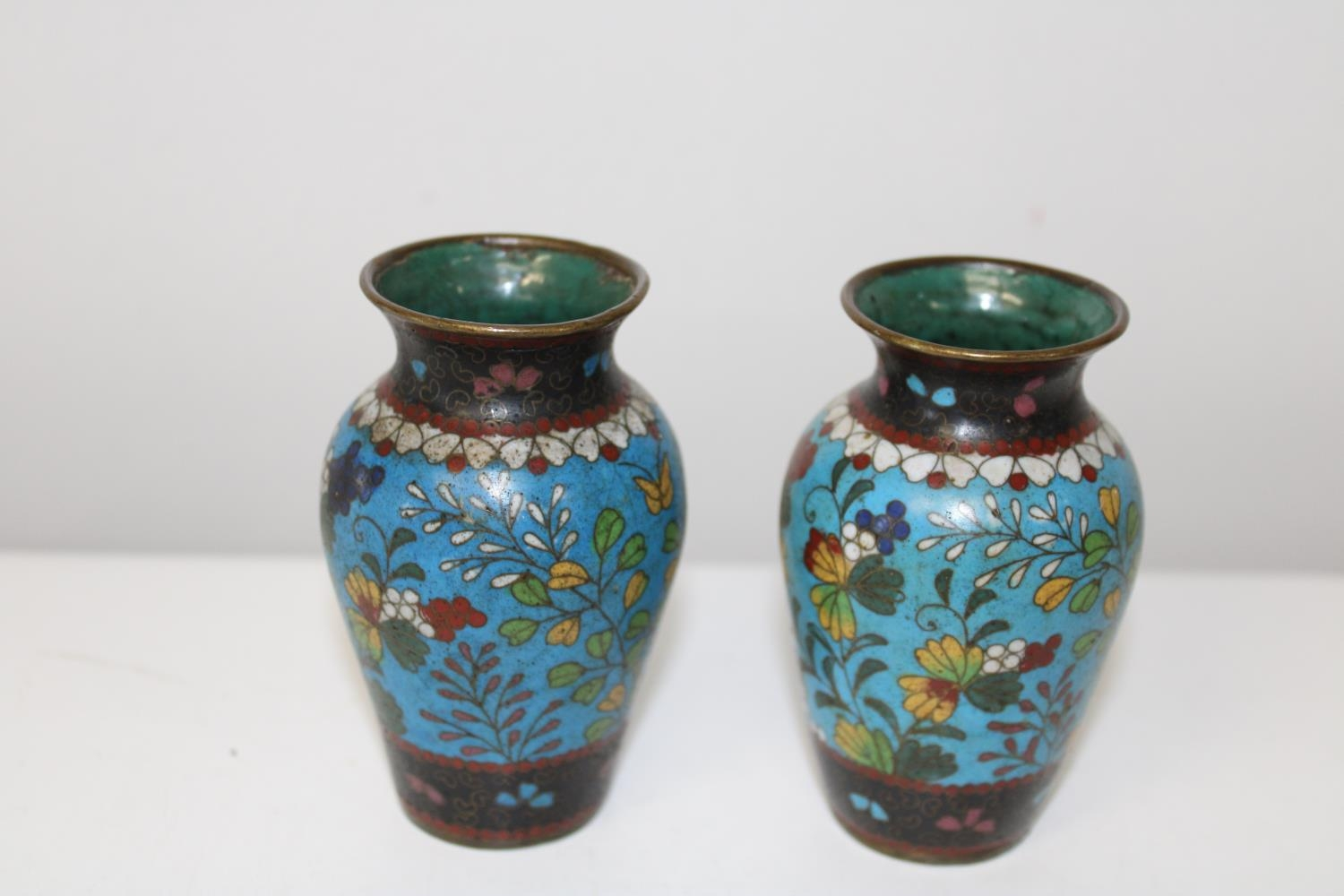 A small pair of 19th century Chinese cloisonne vases in good condition (sold as seen) Height 10cm