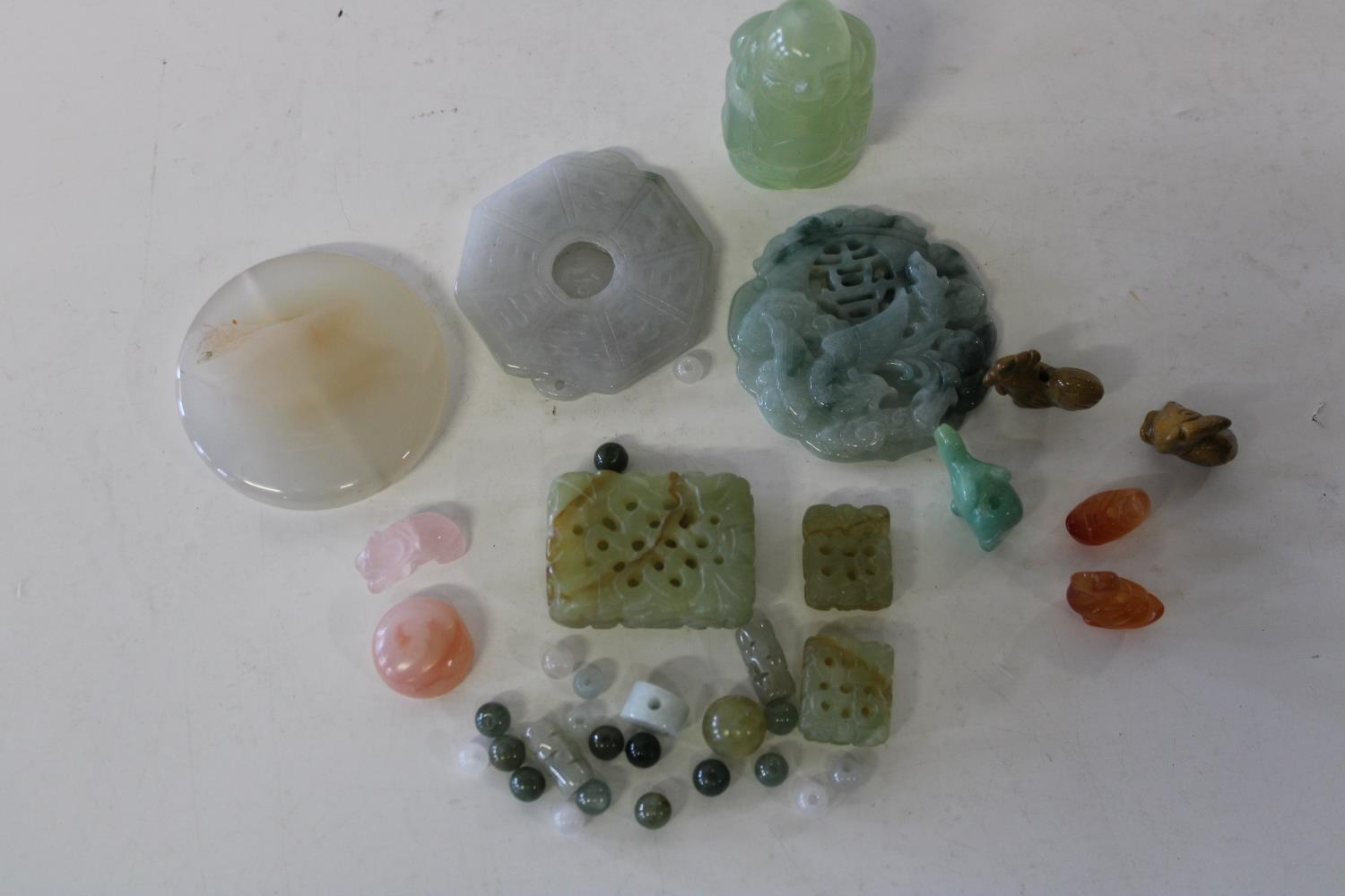 A selection of assorted jade items