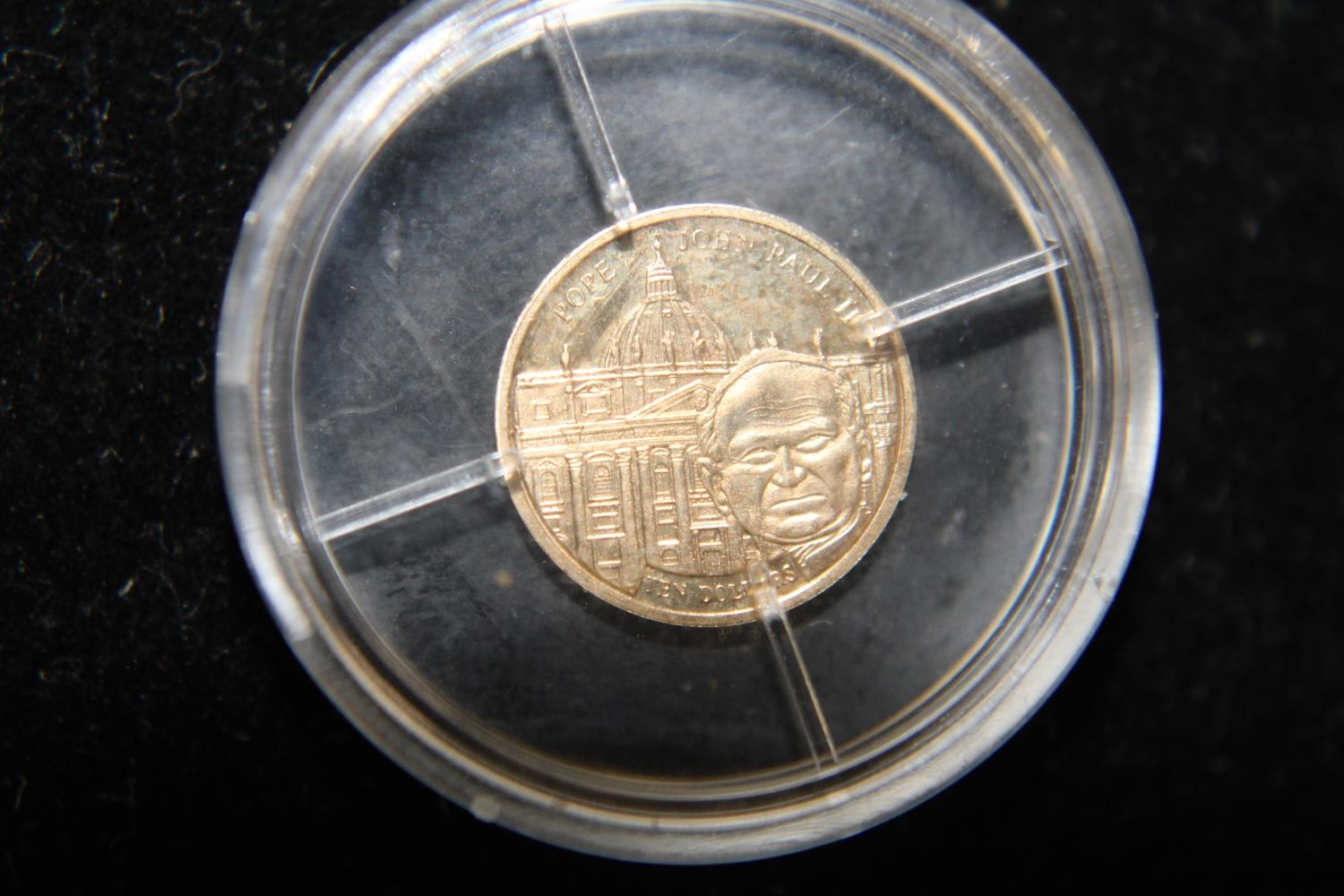 A 24ct gold 2003 Liberia 10 dollar proof coin 0.5 grams