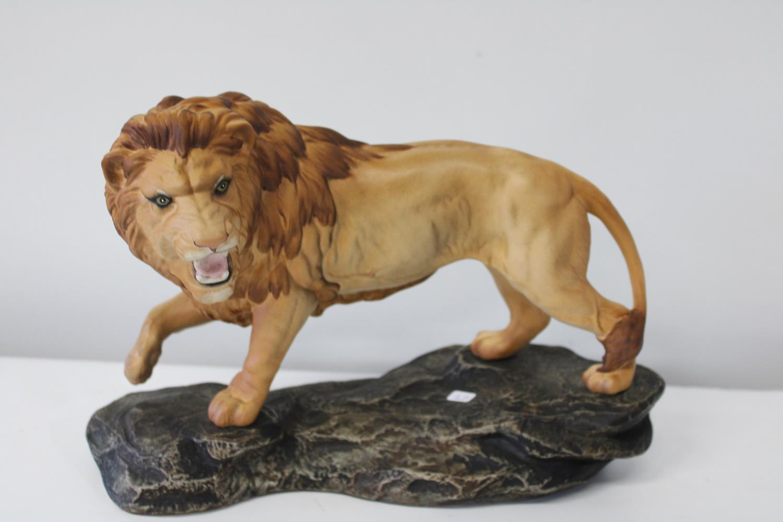 A large Beswick lion figure 29cm x 22cm