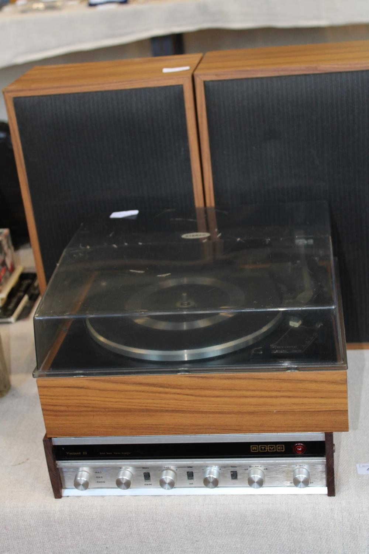 A vintage Garrard turntable with amplifier & speakers