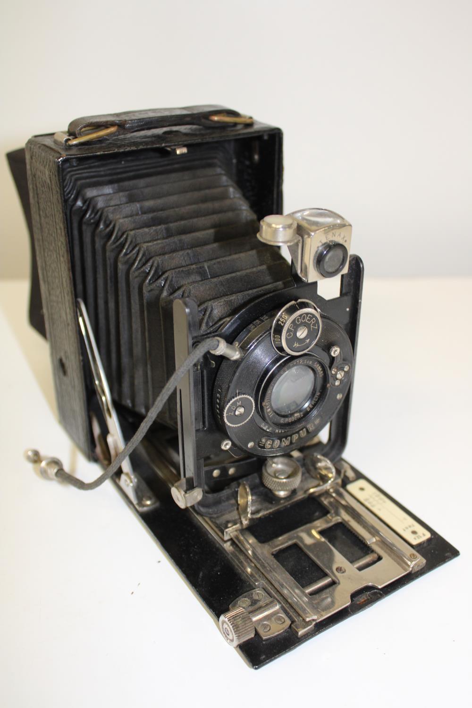 A vintage folding plate camera
