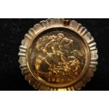 A 1982 22ct gold half sovereign in a 9ct gold mount total weight 5.8 grams