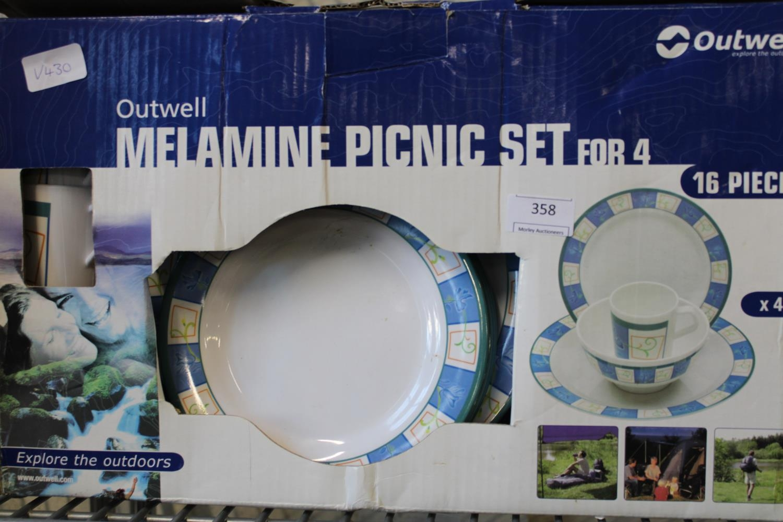 A boxed four setting picnic set