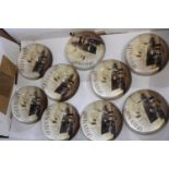 Nine Queen Mary paperweights