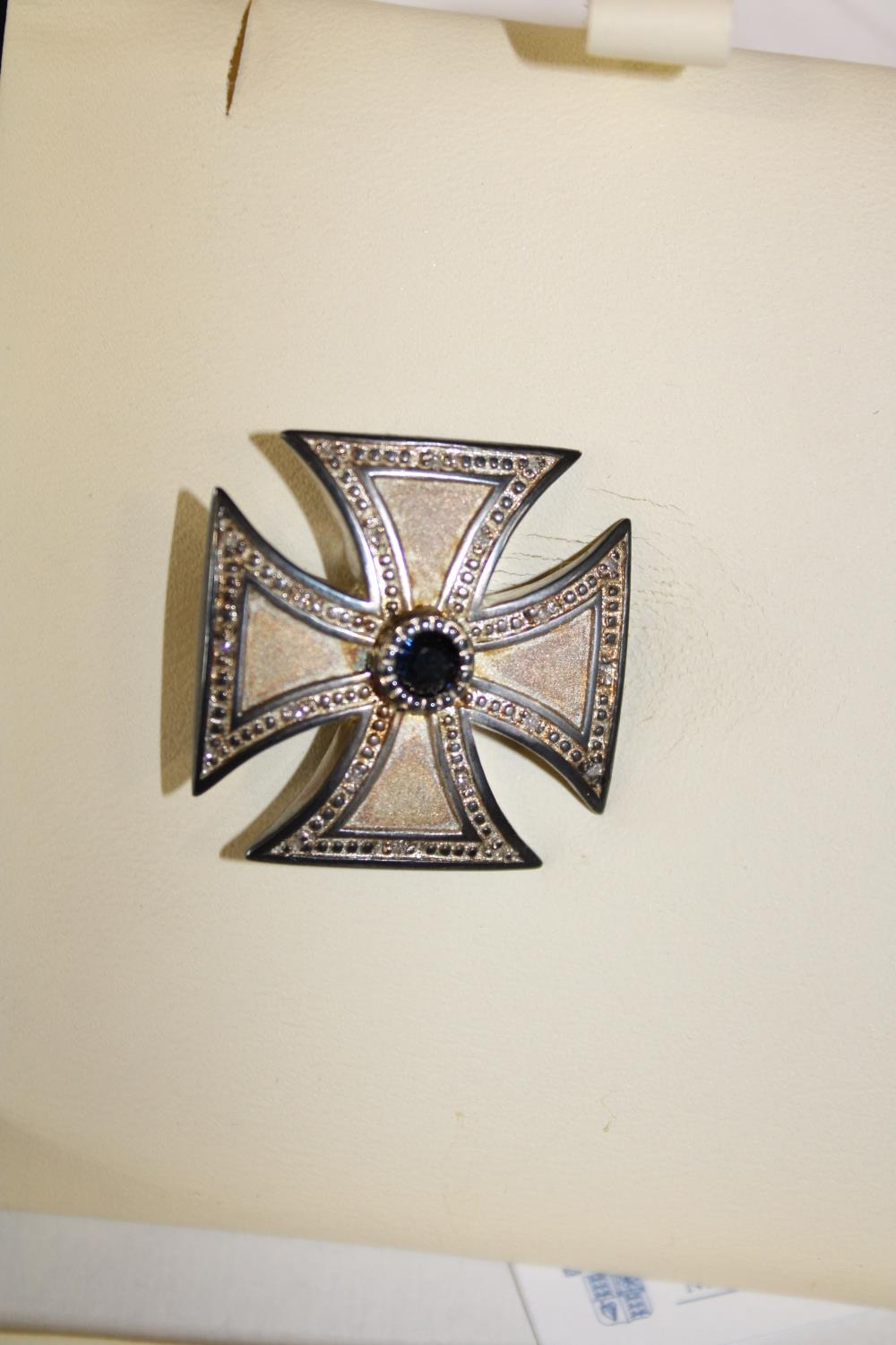 A Royal Mint hallmarked silver Victoria Cross brooch with sapphire