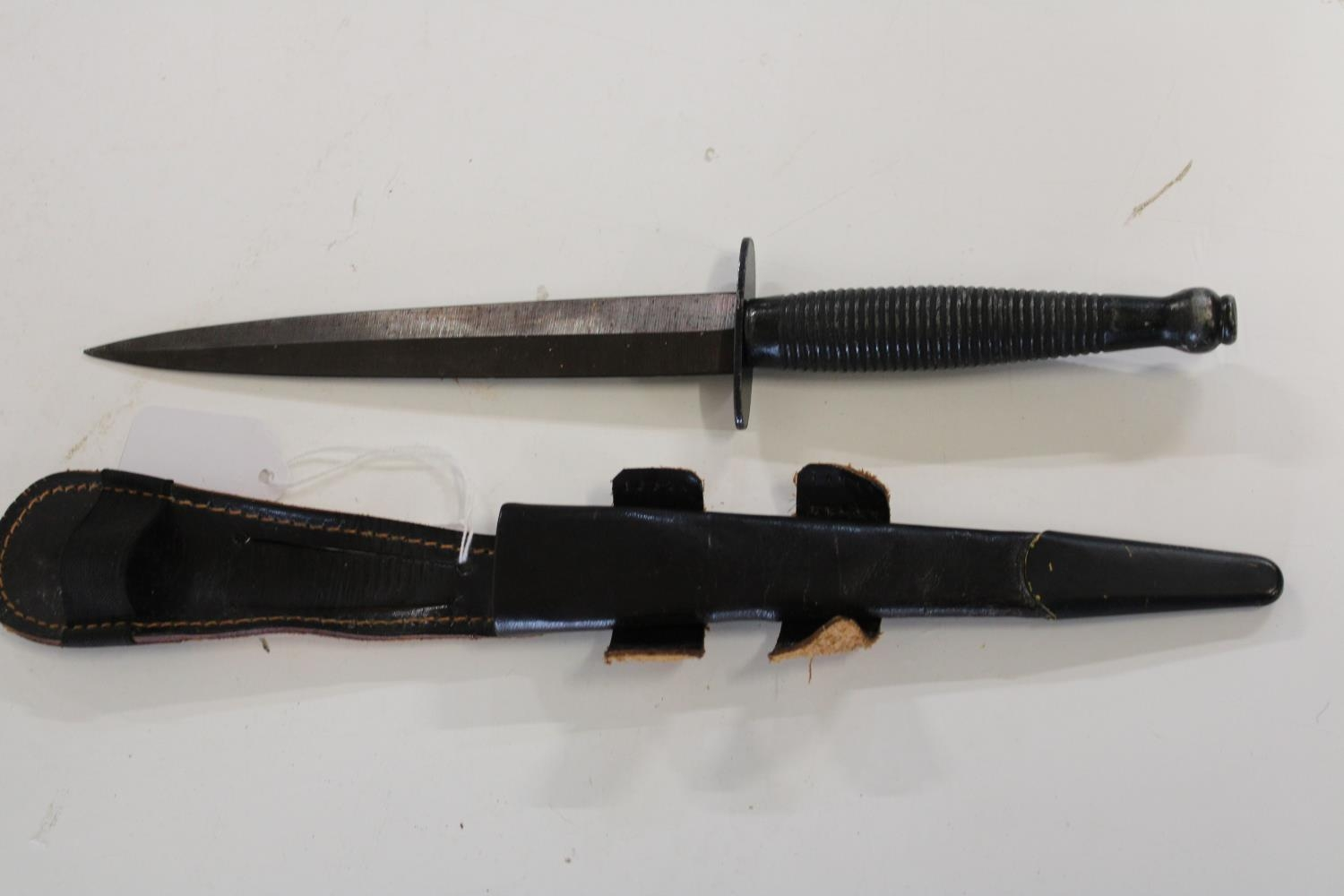 A Post War Fairbairn Sykes pattern 3 Commando fighting knife with sheath (believed to by a trophy