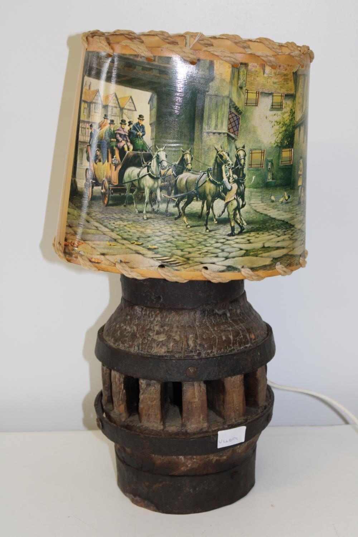 A vintage cartwheel hub table lamp & shade