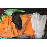 A suitcase full of assorted garment/suit carriers