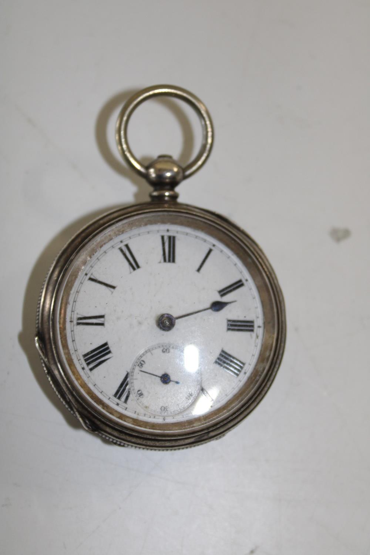 A hallmarked silver open faced pocket watch (as found) not running