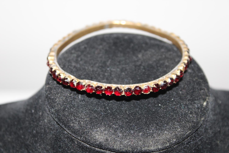 A vintage gilt metal & garnet bracelet