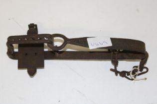 An antique gin trap length 24cm