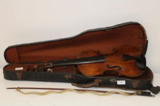 An antique cased violin. Sold as seen