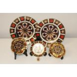 Six pieces of collectable Royal Crown Derby. Larger plates 21.5cm in dia. Smaller plates 11cm in