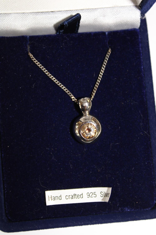 A 925 silver pendant & chain