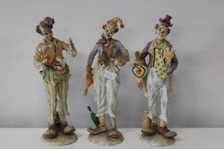 Three large Leonardo clown figures Height 43cm (as found)