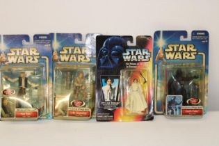 Four boxed Star Wars figures