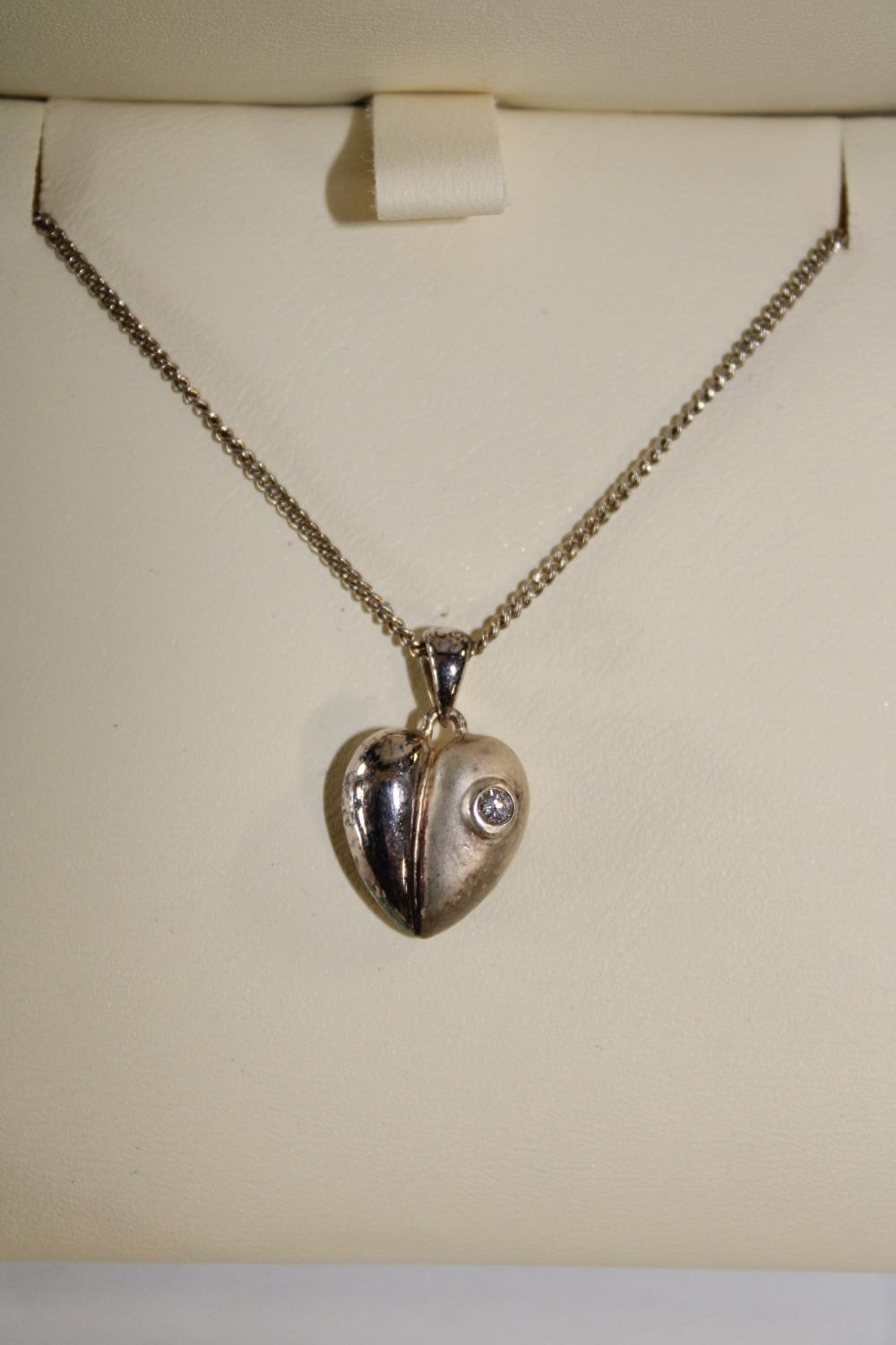 A Royal Mint moonlight silver & diamond heart pendant with silver chain